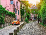 View of old street in quarter Montmartre in Paris, France.